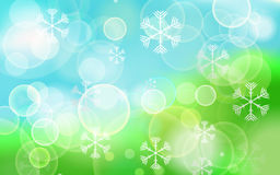 Abstract festive bokeh lights with snowflakes on Christmas abstr Stock Photos