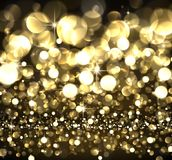 Abstract festive golden luminous background. Stock Image