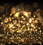 Abstract festive golden luminous background. Royalty Free Stock Images