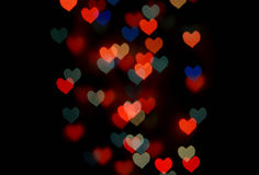 Abstract festive heart bokeh background Royalty Free Stock Photo