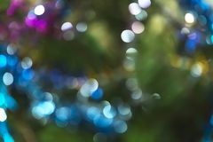 Abstract festive New Year Christmas defocused background with bokeh multicolored effect on a green background with copy space.  stock photo