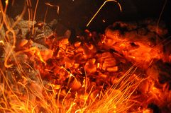Trails of flame sparks. Burning traces glowing over black backdrop. Abstract fiery background. Orange color fire sparks closeup. Abstract fiery background royalty free stock photo