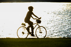 Abstract figure of person riding a bike Royalty Free Stock Images