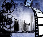 Abstract film strip background with stylized city skyline and  projector. Abstract film strip background with stylized city skyline and old projector. Blue tones Stock Photography