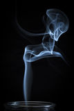 An Abstract Fine Blue Smoke Flowing From Vertical Bottle Background Stock Photos