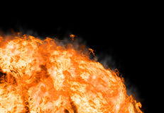 Abstract fire on black background. Bright explosion flash on a black backgrounds Stock Images