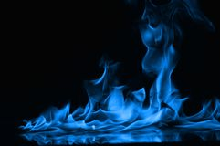 Abstract Fire flames isolated on black background. Beautiful fire blue flames on a black background Royalty Free Stock Photos