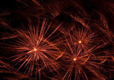 Abstract of Fireworks on Black Background. A shot of red fireworks set against a black sky Stock Photos