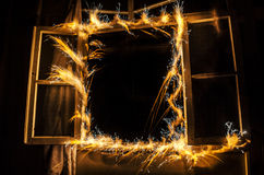 Abstract fireworks flame freezelight on window. Apartment building on Fire at Night time. Fire concept. Azerbaijan. Abstract fireworks flame freezelight on Stock Photo