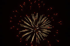 Abstract Fireworks: Red Lights Surrounding Glitter Royalty Free Stock Photos
