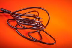Abstract  flexible audio cable on orange, nice Royalty Free Stock Photography