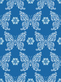 Abstract floral butterflies on blue background Royalty Free Stock Photos