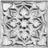 Abstract floral ornament, bas-relief. Abstract floral ornament, a stone bas-relief on the wall Royalty Free Stock Photography