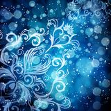 Abstract floral pattern on a blue background. Abstract floral pattern on a blue background, made of transparent rays, stars, bokeh. Magical fantasy flowers vector illustration
