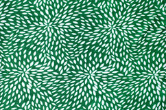 Abstract floral pattern on green fabric. Royalty Free Stock Photos