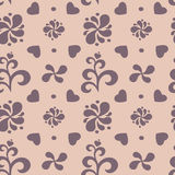 Abstract floral seamless pattern on beige background. Stock Photos