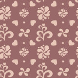 Abstract floral seamless pattern on brown background. Stock Photos