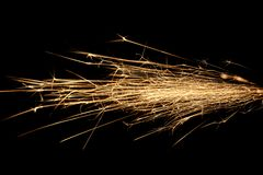 Sparks on black. Abstract flow of sparks isolated on black Royalty Free Stock Photo