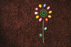 Abstract flower with colored eggs on the carpet.easter. flat la Stock Photo