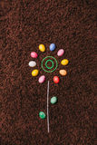 Abstract flower with colored eggs on the carpet.easter. flat lay Royalty Free Stock Photos