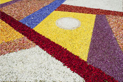 Abstract flowers carpet at the festival of Corpus Christi, Tenerife, Canary islands. The Corpus Christi flower carpets in La Orotava are created by local Royalty Free Stock Image