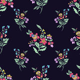 Abstract flowers seamless pattern, floral background. Fantasy bright multicolored  on a dark blue backdrop. For the Stock Photography