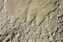 Abstract flowing wet mud close up texture Stock Images