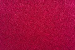 Abstract fluffy texture of textile fabric of crimson color Stock Photography