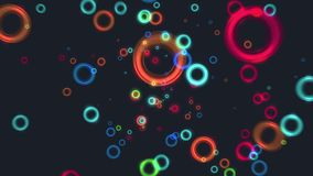 Abstract flying colorful glow circles particles animation