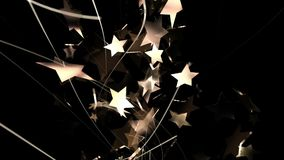 Abstract flying stars in golden color stock video footage