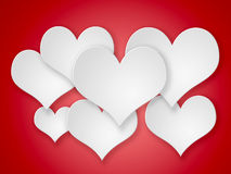 Abstract flying  white hearts on red background. Stock Image