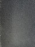 Abstract foam texture, on black background, with bubbles. stock photography