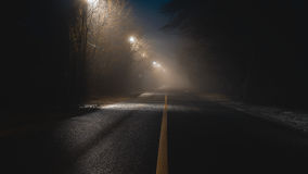 Abstract fogy road. With lanterns at night Royalty Free Stock Photography