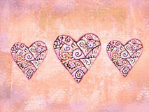 Abstract folkloric hearts on grunge background wth ethnic motif. Decoration for ethnic design. Love hearts. Abstract folkloric hearts on grunge background in Royalty Free Stock Images