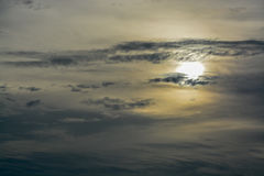 The abstract formation and texture of the clouds over and around the sun. Above the Gulf of Mexico in florida Stock Photos