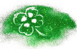 Abstract four-leaf clover of green glitter sparkle on white Stock Photography