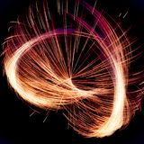 Abstract Fractal spinning Illumination with red and orange lines stock photos