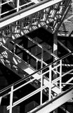 Abstract fragment of metal stairs. Distinctive contemporary composition with geometric structure in black and white Stock Photography