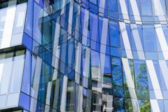 Abstract fragment of modern architecture, walls made of glass an royalty free stock images