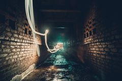 Abstract freezelight or freeze light painting in brick urban tunnel Royalty Free Stock Image