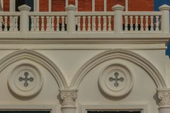 Abstract French balconies which decorated in circle shape above. Arch door on stucco wall background Royalty Free Stock Image