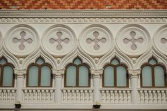 Abstract French balconies which decorated in circle shape above. Arch door on stucco wall background Royalty Free Stock Photo