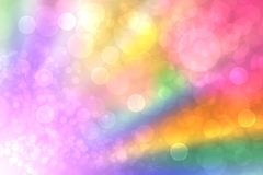 Abstract fresh vivid colorful fantasy rainbow background texture with smooth rays and defocused bokeh lights. Beautiful light