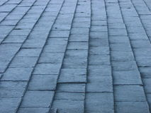 Abstract frosted slate roof tiles. Abstract view of frosty tiled roof. Strong perspective giving converging parallel lines Stock Photo