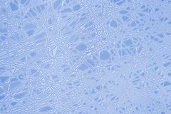 Abstract frosty pattern. On the glass toned in blue Royalty Free Stock Image