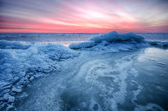 Abstract frozen winter sunrise seascape with ice and colored the sky. Frozen winter sunrise seascape with ice and colored the sky Stock Images