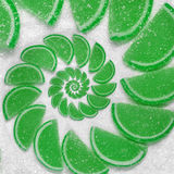 Abstract fruit jelly wedges green orange cantle lobule on white sugar background. Jellies. Sweet fruit segments. Juicy fruit jelly. On sugar sand Abstract food Stock Images