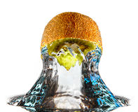 Abstract fruit water splash. Abstract inverted kiwi fruit water splash like a bullet royalty free stock photo