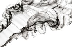 Abstract fume pattern: black smoke swirls and curves stock images