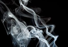 Abstract fume shapes on black stock photography
